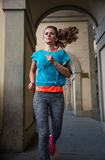 Fitness woman jogging outdoors in the city Royalty Free Stock Image