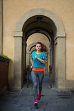 Fitness woman jogging outdoors in the city. Fitness modern woman jogging outdoors in the city Stock Images