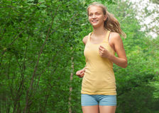 Fitness woman jogging in park Royalty Free Stock Images