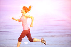 Fitness woman jogging at sunrise/sunset beach. Healthy lifestyle fitness woman jogging at sunrise/sunset beach Royalty Free Stock Image