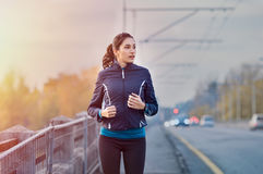 Fitness woman jogging in winter Stock Images