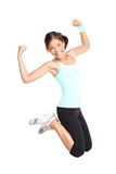 Fitness woman jumping. Excited isolated on white background. Full body image of beautiful multiracial Asian Caucasian female model in jump flexing and showing Royalty Free Stock Photo