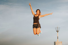 Fitness woman jumping in the air. Stock Image