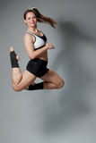 Fitness woman jumping of joy Royalty Free Stock Image