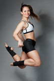 Fitness woman jumping of joy Royalty Free Stock Photos