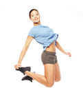 Fitness woman jumping of joy. Royalty Free Stock Photos