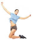 Fitness woman jumping of joy. Royalty Free Stock Images