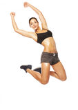 Fitness woman jumping of joy. Royalty Free Stock Image