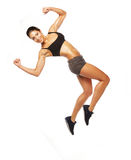 Fitness woman jumping of joy. Stock Photo