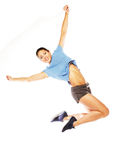 Fitness woman jumping of joy. Royalty Free Stock Photo