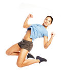 Fitness woman jumping of joy. Stock Photography