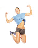 Fitness woman jumping of joy. Stock Image