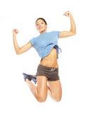 Fitness woman jumping of joy. Stock Image