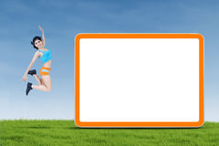 Fitness woman jumping next to copyspace Royalty Free Stock Image