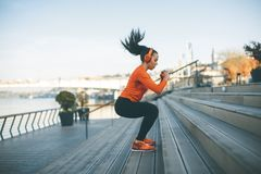 Fitness woman jumping outdoor royalty free stock photos