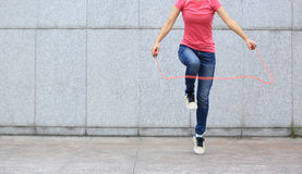 Fitness woman jumping rope outdoor Royalty Free Stock Images