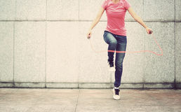 Fitness woman jumping rope outdoor Royalty Free Stock Image