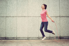 Fitness woman jumping rope outdoor Stock Photo