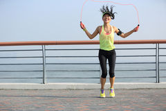 Fitness woman jumping rope at seaside Royalty Free Stock Photography