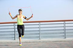 Fitness woman jumping rope at seaside Stock Photos