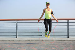 Fitness woman jumping rope at seaside Stock Image