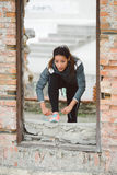 Fitness woman lacing running shoes for outdoor workout Stock Image