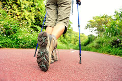 Fitness woman legs hiking on trail Stock Photography