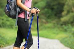 Fitness woman legs hiking on trail Royalty Free Stock Photography