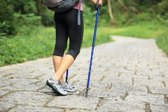 Fitness woman legs hiking on trail Royalty Free Stock Photo