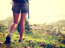 Fitness woman legs hiking on trail Stock Images