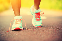 Fitness woman legs running at forest trail Stock Images