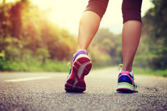 Fitness woman legs running at forest trail Royalty Free Stock Photos