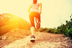 Fitness woman legs running on trail Stock Photos