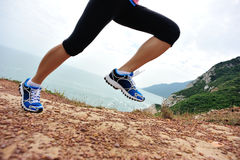 Fitness woman legs running on trail Royalty Free Stock Photography
