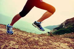 Fitness woman legs running on trail Royalty Free Stock Images