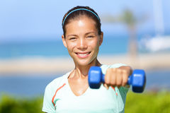Fitness woman lifting dumbbell weight training Stock Photos