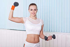 Fitness woman lifting dumbbells Royalty Free Stock Photography