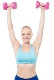 Fitness woman lifting dumbbells Royalty Free Stock Photos
