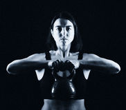 Fitness woman lifting kettle bell Royalty Free Stock Photo