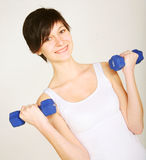 Fitness woman lifting weights Royalty Free Stock Photo