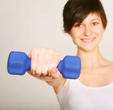 Fitness woman lifting weights Stock Photography