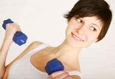 Fitness woman lifting weights Stock Images