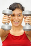 Fitness woman lifting weights Royalty Free Stock Photography