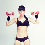 Fitness woman lifting weights Stock Photos