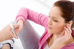 Fitness - woman listen music mp3 relax Royalty Free Stock Image