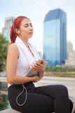 Fitness woman listening to music Stock Image