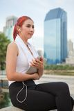 Fitness woman listening to music Royalty Free Stock Images