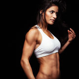 Fitness woman looking away thinking Royalty Free Stock Photos