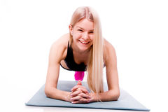 Fitness woman looking at camera isolated on white background. Sm Stock Photos