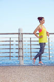Fitness woman looking into distance and listening to the music Stock Photo